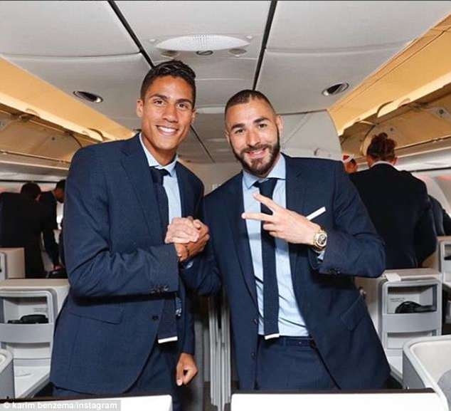 Raphael Varane (left) and Karim Benzema (right) were pictured on board the private jet to Kiev