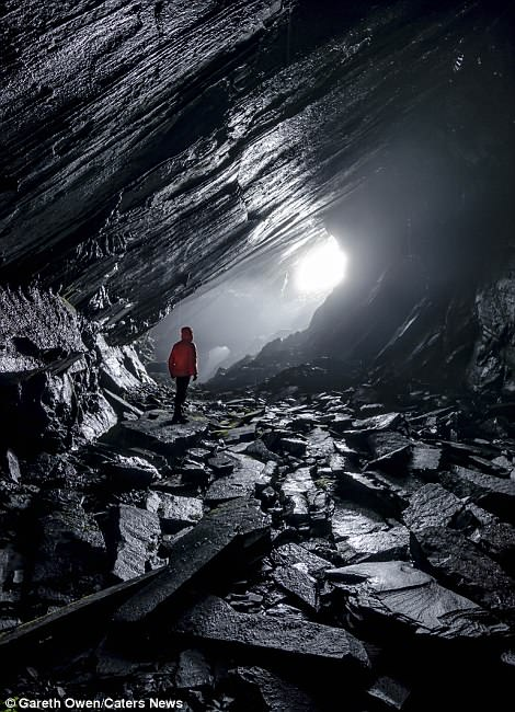 The photographer explores the caves ofMynydd Deulyn