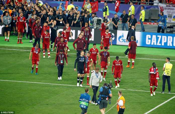The Liverpool squad walk around the pitch showing their dejection following their final heartbreak against Madrid