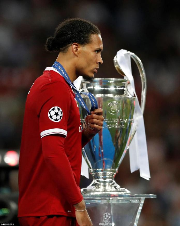 Virgil van Dijk walks past the trophy without glancing at it as he comes to terms with the hard-to-take defeat