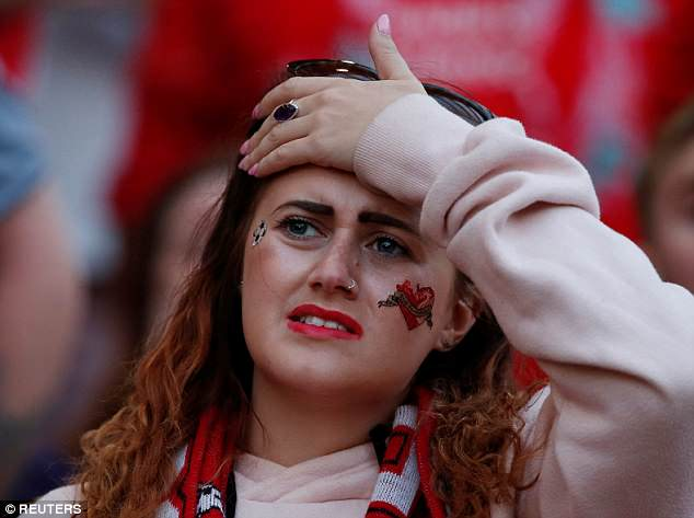 Disappointment: More than 30,000 Liverpool fans began the long journey home after a shocking defeat at the hands of Real Madrid