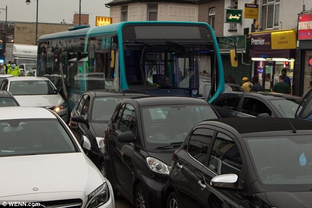 Brian Barnett tweeted: 'Serious accident in Dartford, my car smashed! About 20 cars involved, hit by bus. My back hurts!'