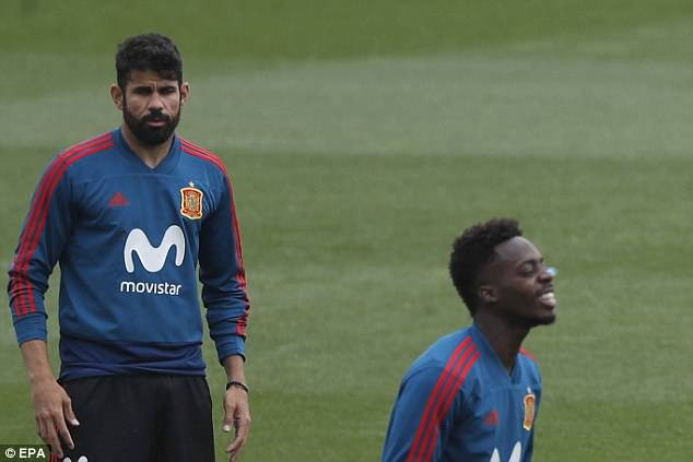 Spain forwards Diego Costa (L) and Inaki Williams (R) take part in the team's training session