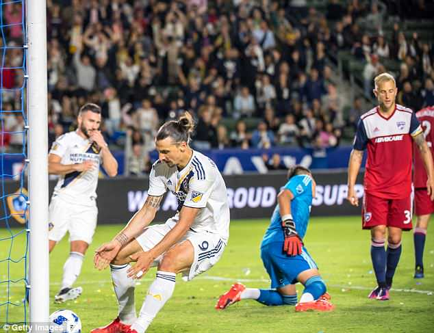 Ibrahimovic retrieves the ball after his second goal at the StubHub Center on Wednesday night