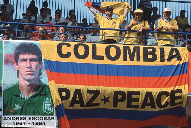 Colombia fans display a banner in tribute to Escobar following his shocking death