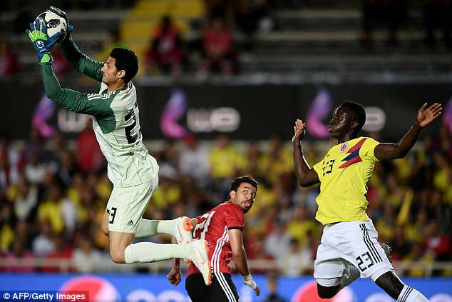 Egypt goalkeeper Mohamed El Shenawy comes flying out to catch a cross during the first half