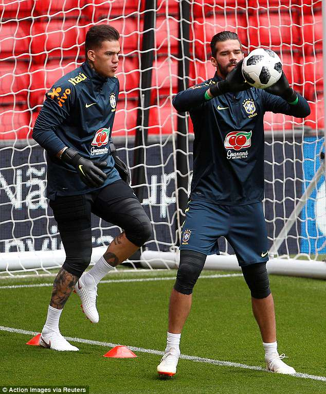 Goalkeeping duo Ederson (left) and Alisson take part in a training drill at Anfield