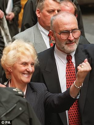 Toni and Ken Cameron, the parents of Stephen Cameron, celebrate outside the Old Bailey in London in 2000