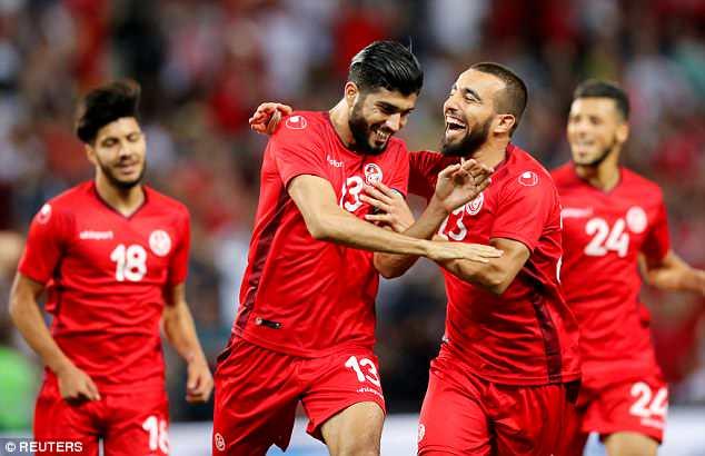 Tunisia's Ferjani Sassi celebrates scoring their second goal in the friendly draw with Turkey