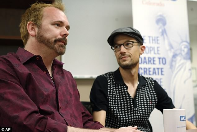 Charlie Craig, left, and David Mullins talk about a U.S. Supreme Court ruling that sets aside a Colorado court decision against a baker who would not make a wedding cake for the same-sex couple as they meet reporters Monday, June 4, 2018, in Denver