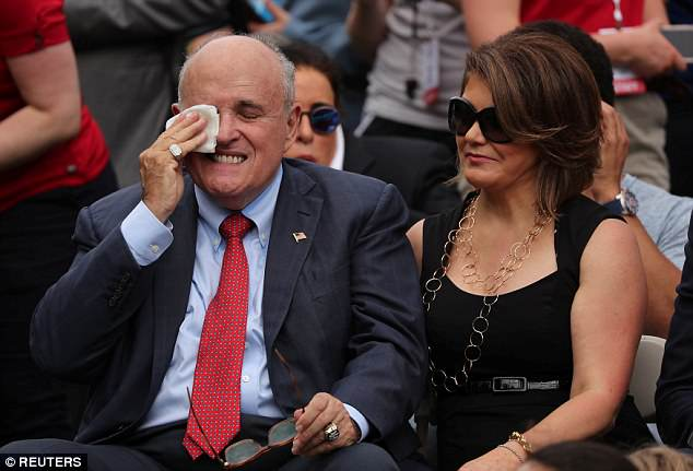 Rudy Giuliani, attorney for U.S. President Donald Trump, wipes his brow as he attends the White House Sports and Fitness Day event with guest Jennifer Leblanc who initially claimed they weren't dating