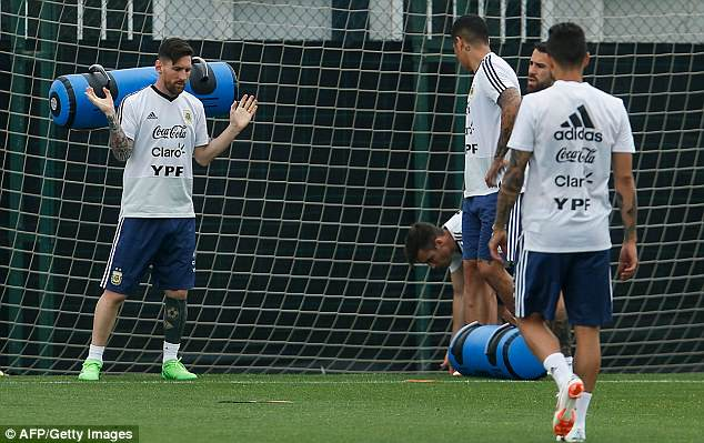 The 30-year-old throws the weight off of him after a hard workout at the Argentina boot camp