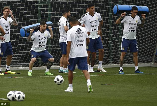 Lionel Messi (c) carries a weight on his shoulders during Argentina training in Barcelona