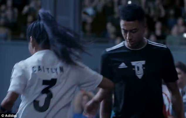 Jesse Lingard (right) gets showed up by famous freestyle footballer Caitlyn Schrepfer