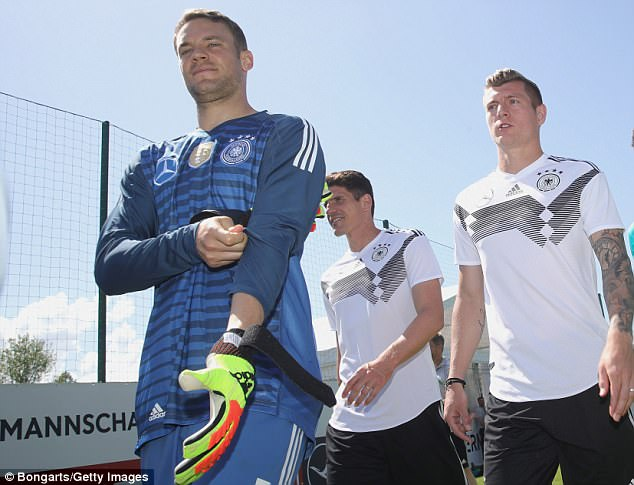 Manuel Neuer leads the German squad out to training after being named captain