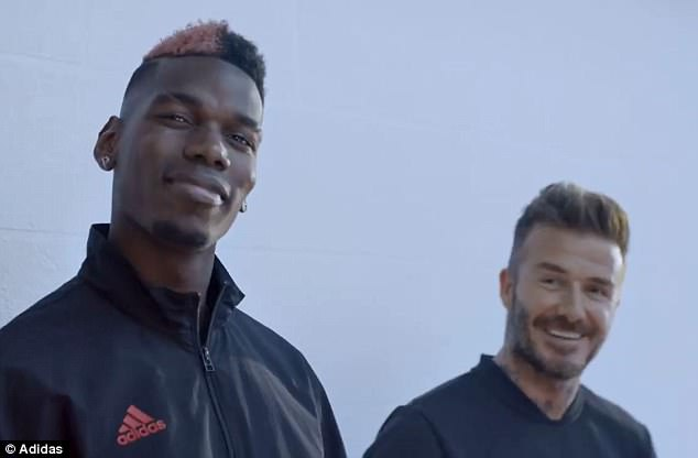 Manchester United midfielder Pogba stands alongside former England captain David Beckham