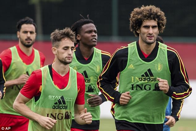 Marouane Fellaini, right, jogs alongside former Manchester United teammate Adnan Januzaj