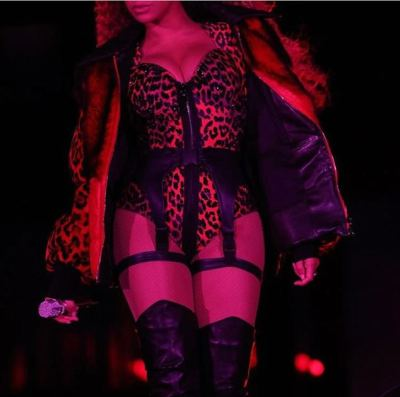 Stunning: The Crazy In Love songstress also changed into a sparkling leopard print bodysuit complete with a silk garter and red fur jacket