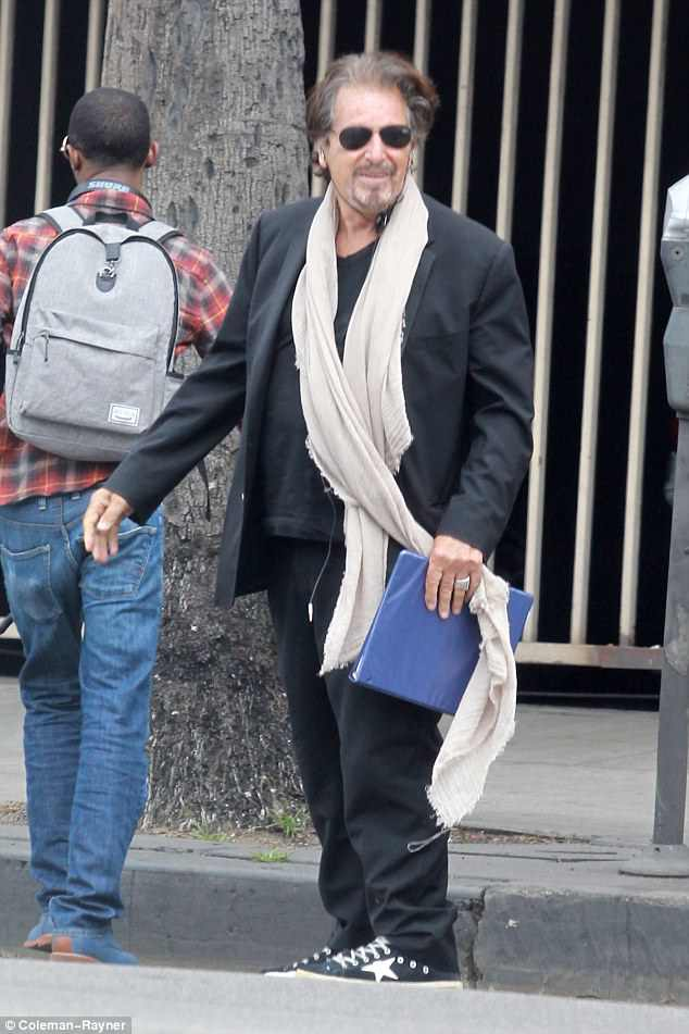 Hoo-ha! Al Pacino wore a huge smile and an even bigger scarf