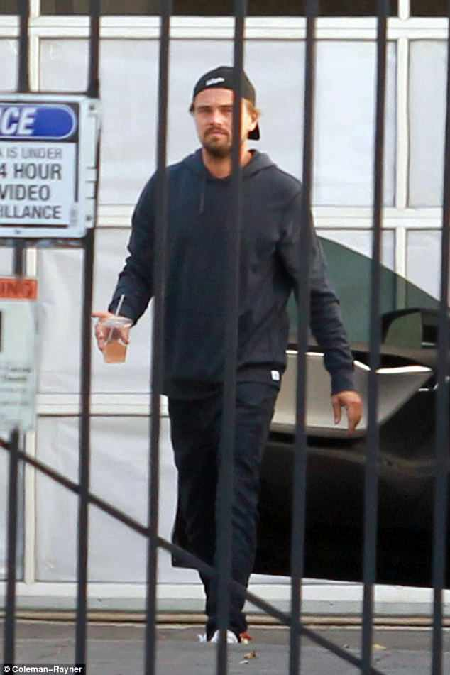 Ready: Leonardo DiCaprio meanwhile looked a little more serious when he turned up