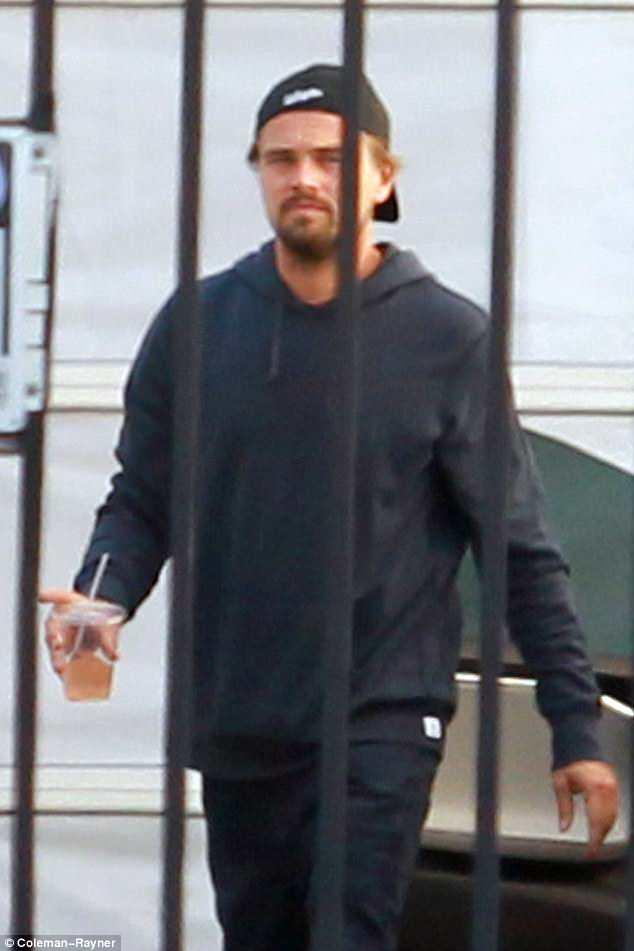 Dark side: He arrived in all black sweatpants, hoodie and baseball cap