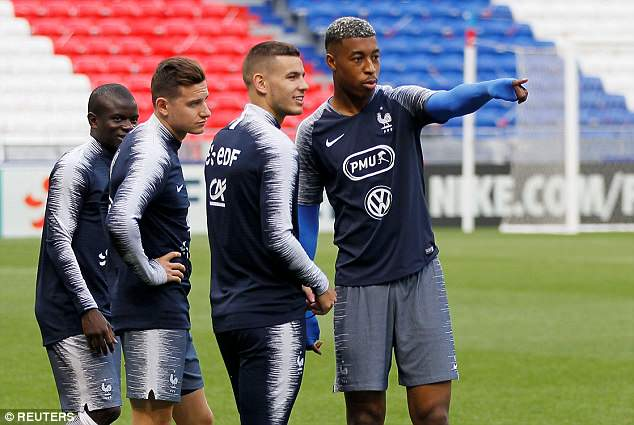 PSG defender Kimpembe points the way to his fellow defender Hernandez as Marseille midfielder Florian Thauvin (second left) and Chelsea's N'Golo Kante (left) watch on