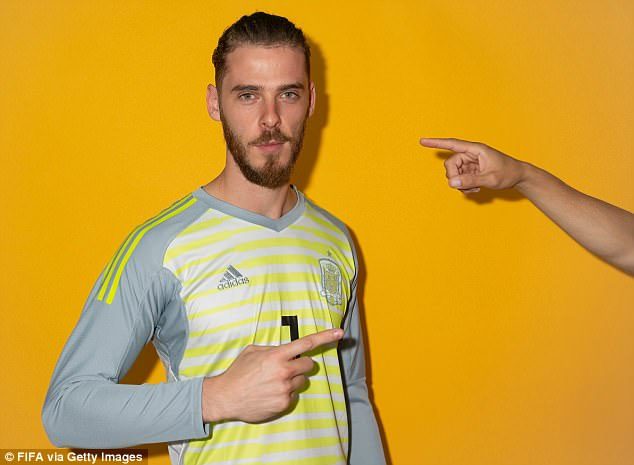 One of De Gea's Spain team-mates photobombs him by pointing back from the side of the shot