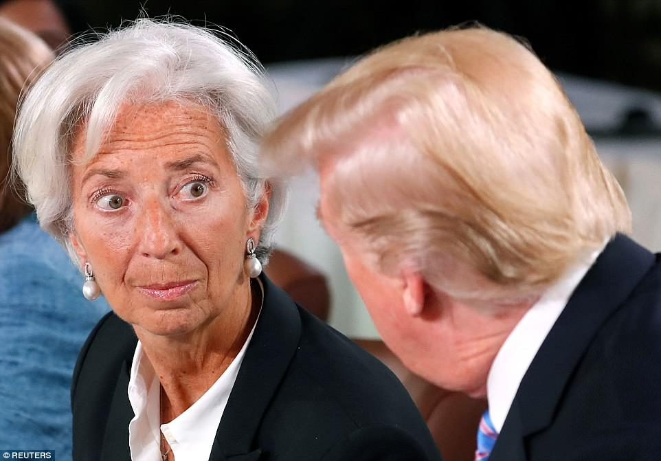 IMF Managing Director Christine Lagarde chats with Trump on Saturday morning at a Gender Equality breakfast meeting