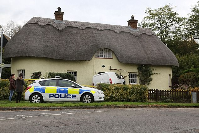 A police car parked up at the crash scene. It cost £20,000 to repair the extensive damage to the picturesque property