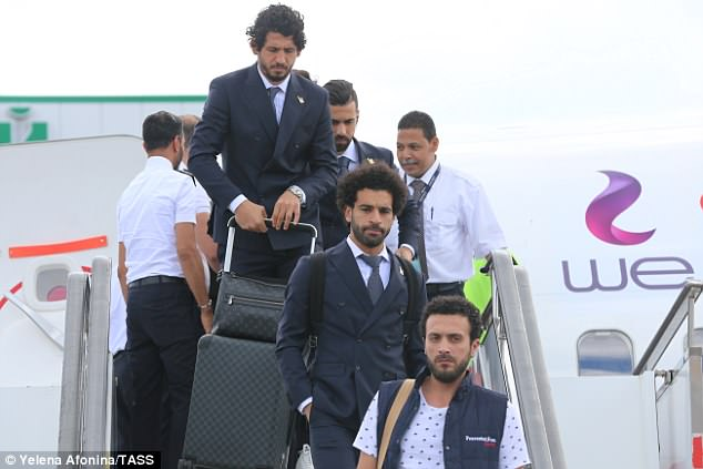 West Brom defender Ahmed Hegazi follows team-mate Salah off the plane in Grozny