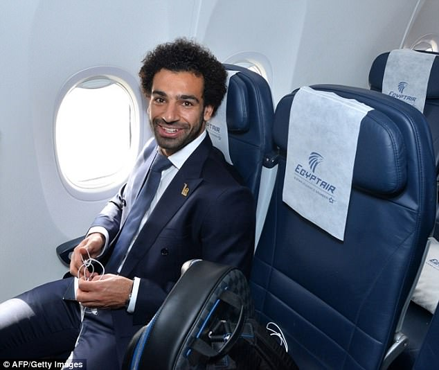 Salah smiles for the camera from his window seat on his way to Russia for the World Cup