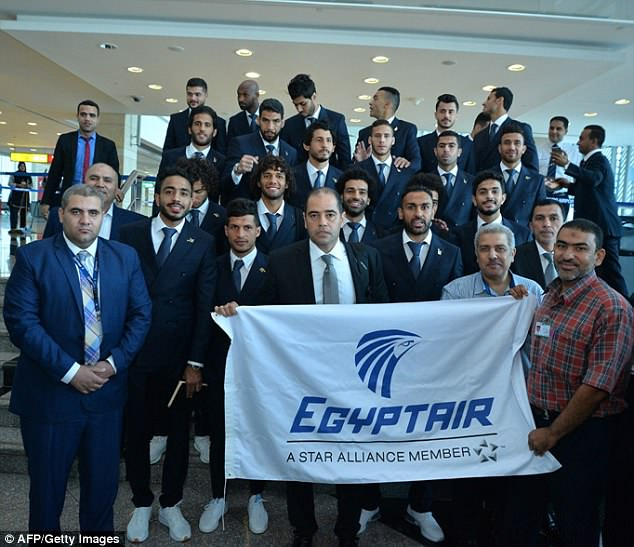 The Egyptian squad pose for a picture as they prepare to board their flight in Cairo