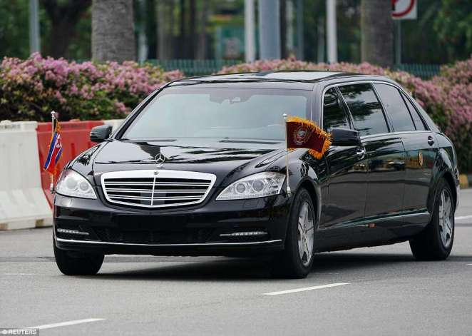 A vehicle believed to be carrying Kim Jong Un travels through Singapore on Sunday