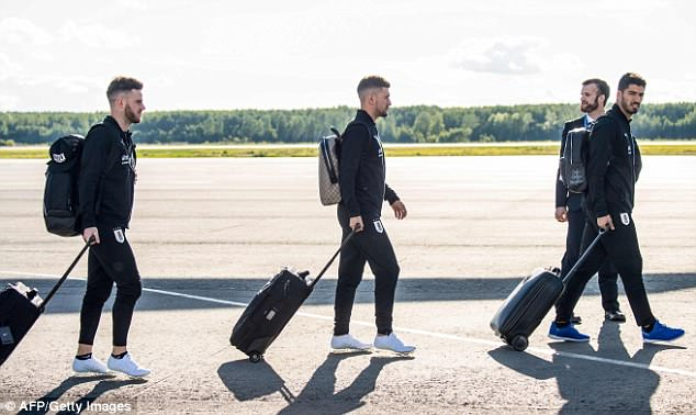 Nahitan Nandez, Giorgian De Arrascaeta and Suarez walk towards the airport after landing