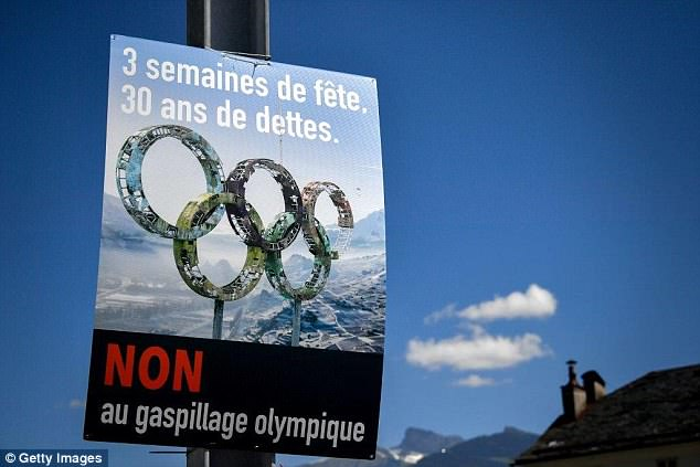 An electoral placard against Sion 2026 Winter Olympics bid hangs in the streets of Collombey