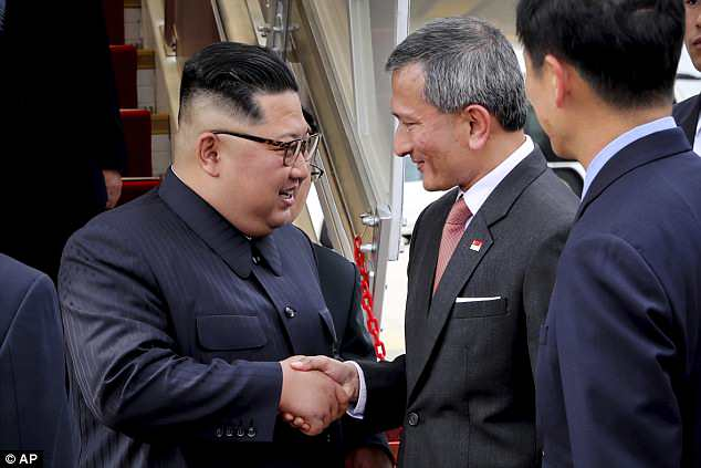 In this photo released by the Ministry of Communications and Information of Singapore, Singapore Minister for Foreign Affairs Dr. Vivian Balakrishnan greets Kim at the Changi International Airport on Sunday