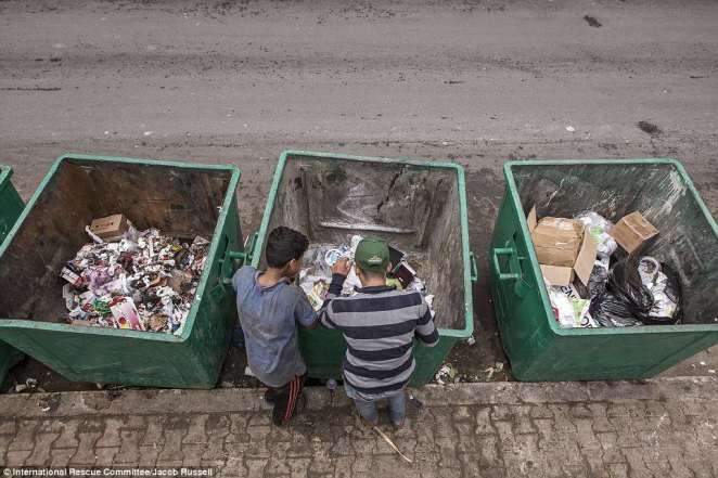 Every day this 14-year-old from Aleppo sorts through garbage in Beirut to find plastic to sell. It usually takes him ten hours to make the equivalent of £10