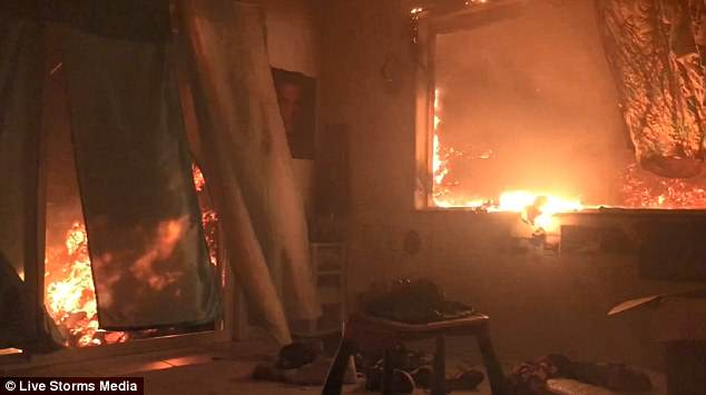 Dramatic footage has captured the moment lava from Hawaii's Kilauea volcano busted through the window of a home inKapoho and gradually burned everything in sight