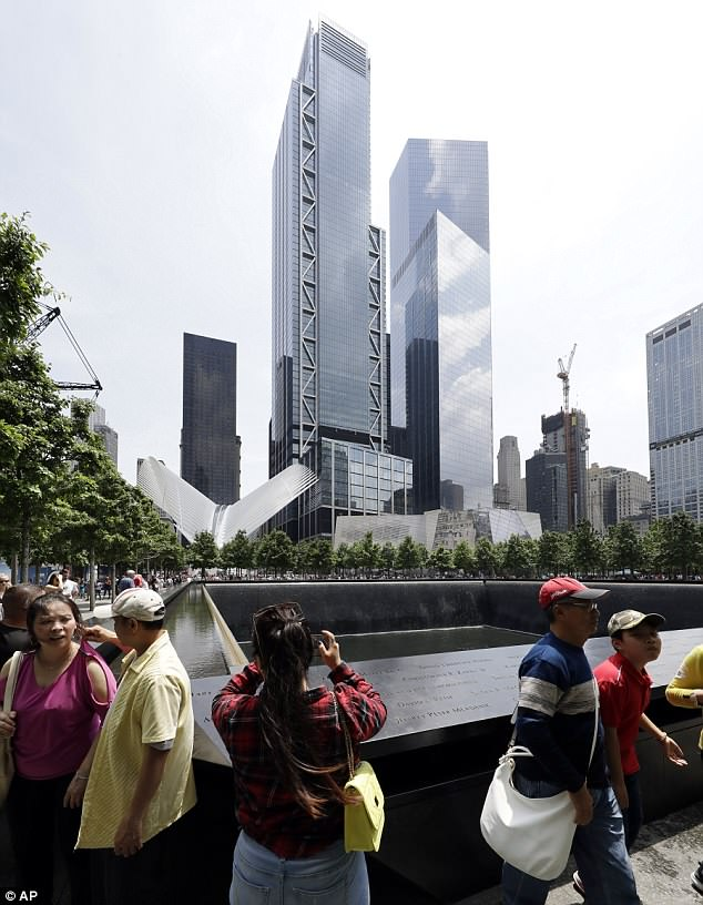 3 world trade center, with its signature zig zag metal looms over visitors at the 9/11 memorial