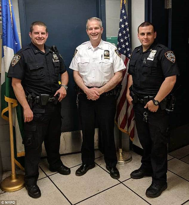 Officer Daniel Newman, Lt Patrick King and Officer Michael Pace rushed the baby to the hospital while giving her CPR