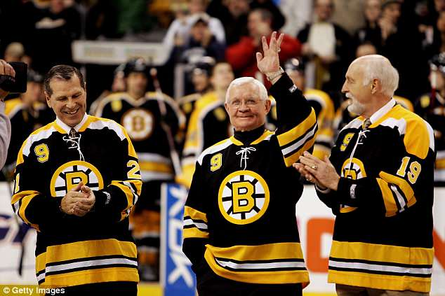 (L-R) Former Boston Bruins players Don Marcotte, John McKenzie and Doug Mohns acknowledge the crowd during the ceremony honoring John Bucyk for his 50 years with the Bruins organization before the game against the Edmonton Oilers on February 13, 2007