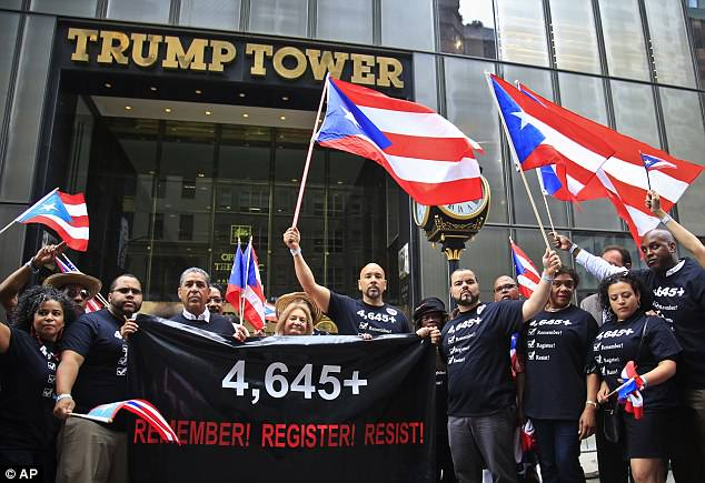 Bronx Borough President Ruben Diaz, center,  poses with marchers in front of Trump Tower reminding the world of the 'tepid' response of the government after Hurricane Maria