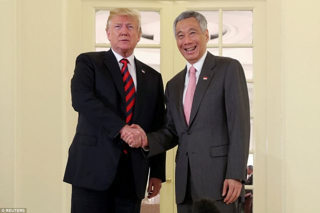 President Donald Trump is spending his afternoon at the presidential palace in Singapore in several sessions and a working lunch with Prime Minister Lee Hsien Loong