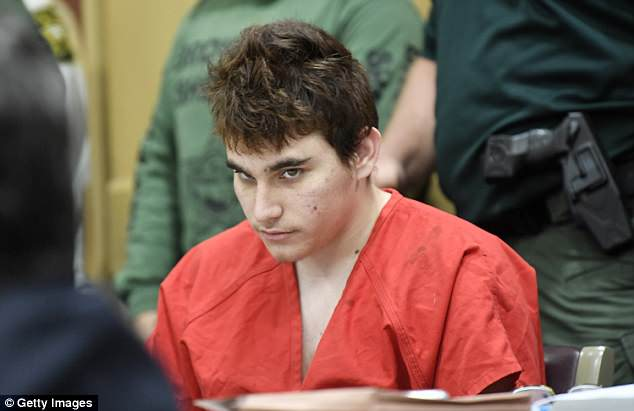 Florida school shooting suspect Nikolas Cruz quickly glances up at the prosecutors during a hearing on April 27, 2018, in Fort Lauderdale