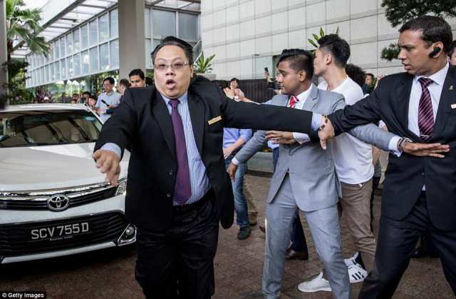 GET BACK! Hotel security staff try to hold back members of the press as the car carrying United States Ambassador to the Philippines Sung Kim tries to leave the Ritz-Carlton hotel after a meeting with North Korean vice-foreign minister Choe Son Hui on Monday