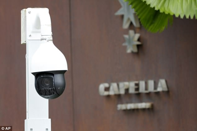 In this Saturday, June 9, 2018, photo, a surveillance camera is seen at the entrance to the driveway of Capella Hotel in Sentosa, Singapore. A new surveillance camera is installed and restaurants closed on Singapore's Sentosa Island, a popular tropical getaway now easing into the political spotlight ahead of Tuesday's summit