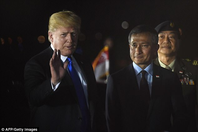He gave a short wave to the press, and told journalists nearby he was feeling 'very good' about his meeting on Tuesday morning local time with Kim Jong-un