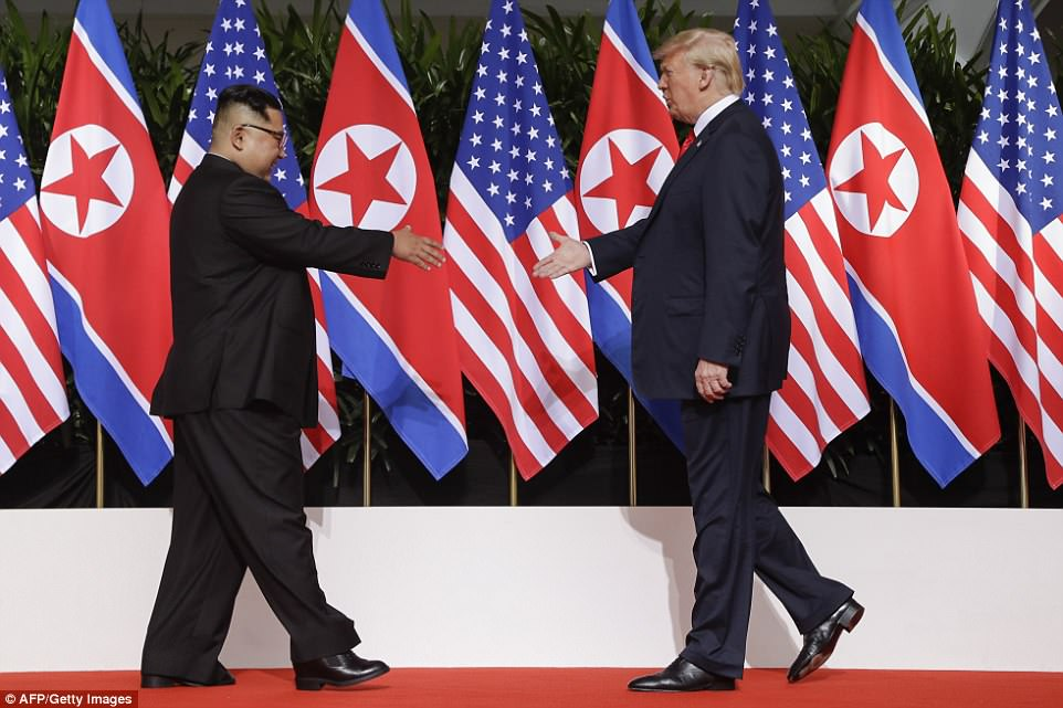 WARM RAPPORT: President Trump touched Kim several times throughout their first exchange, signaling to the dictator he wanted to build a relationship that can stand the test of time and not just today's summit