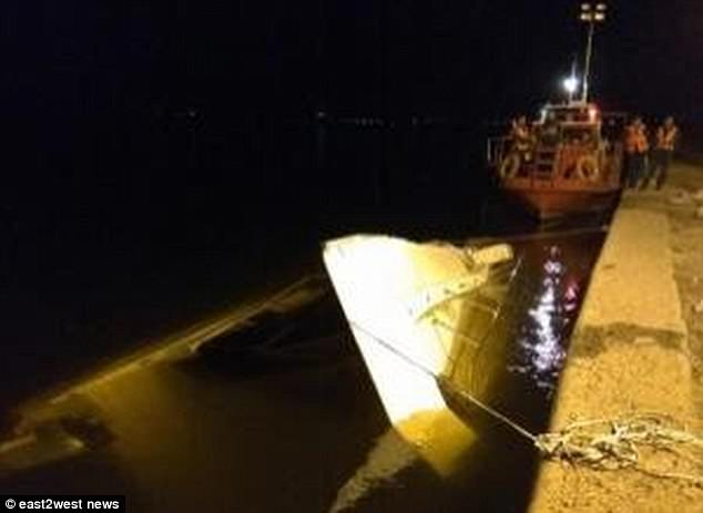 The unlicensed catamaran was dragged to the shore after the crash with a barge