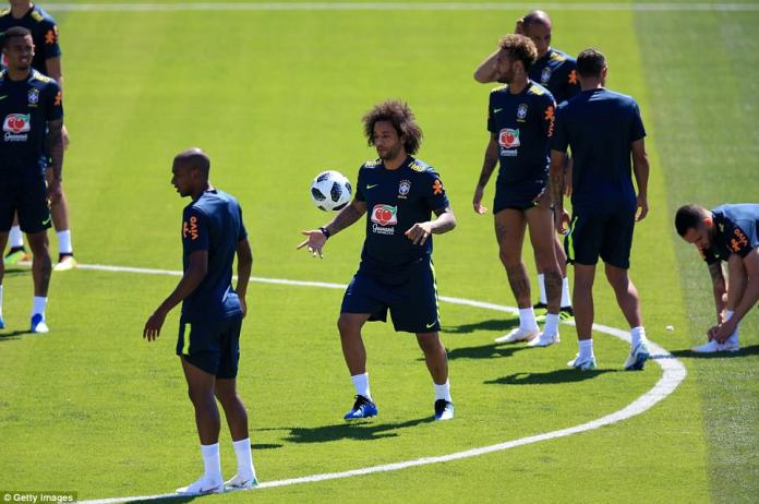 Real Madrid wing back Marcelo controls the ball before popping it off to another Selecao superstar during training